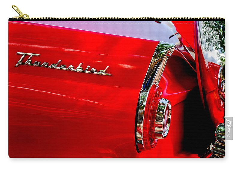 1956 Ford Thunderbird Taillight Emblem Carry-all Pouch featuring the photograph 1956 Ford Thunderbird Taillight Emblem by Jill Reger