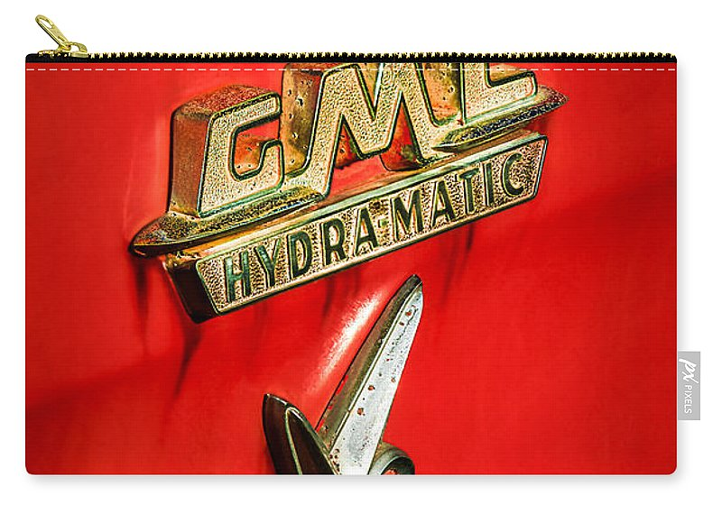 1957 Gmc Hydramatic V8 Emblem Carry-all Pouch featuring the photograph 1957 Gmc Hydramatic V8 Emblem by Jill Reger