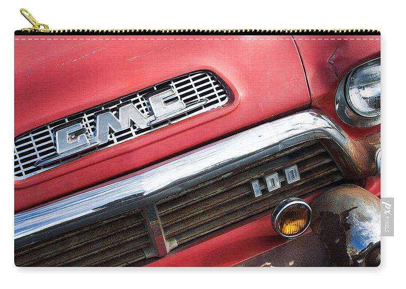 1957 Gmc V8 Pickup Truck Grille Emblem Carry-all Pouch featuring the photograph 1957 Gmc V8 Pickup Truck Grille Emblem by Jill Reger