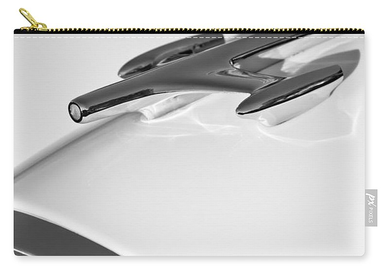 1957 Oldsmobile Hood Ornament Carry-all Pouch featuring the photograph 1957 Oldsmobile Hood Ornament by Jill Reger
