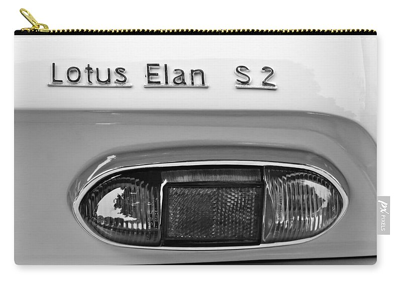 1965 Lotus Elan S2 Taillight Emblem Carry-all Pouch featuring the photograph 1965 Lotus Elan S2 Taillight Emblem by Jill Reger