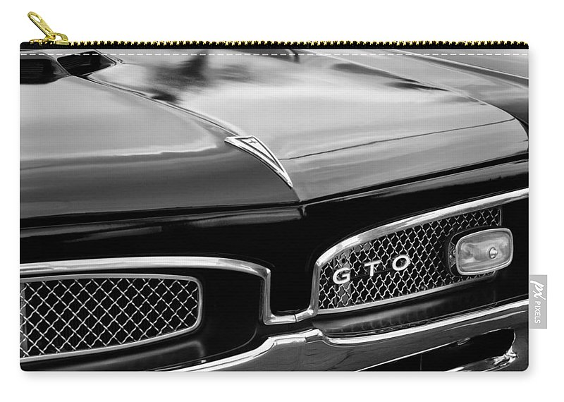 82649e21c 1967 Pontiac Gto Grille Emblem Carry-all Pouch featuring the photograph  1967 Pontiac Gto Grille
