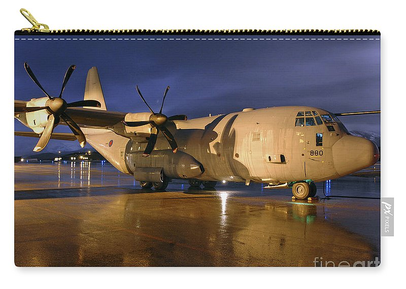 Raf Lyneham Carry-all Pouch featuring the photograph A Royal Air Force C130j Hercules by Paul Fearn