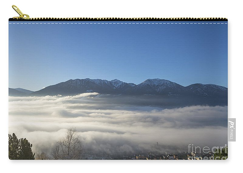 Sea Of Fog Carry-all Pouch featuring the photograph Alpine Village Under Sea Of Fog by Mats Silvan