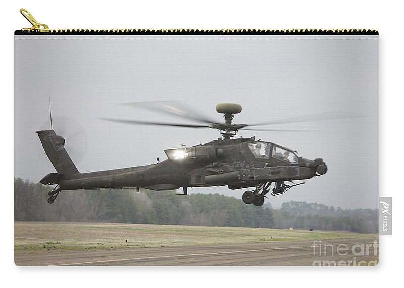 Aircraft Carry-all Pouch featuring the photograph An Ah-64 Apache Helicopter In Midair by Terry Moore