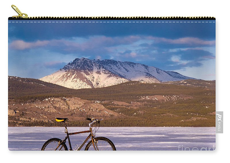 Adventure Carry-all Pouch featuring the photograph Bike On Frozen Lake Laberge Yukon Canada by Stephan Pietzko