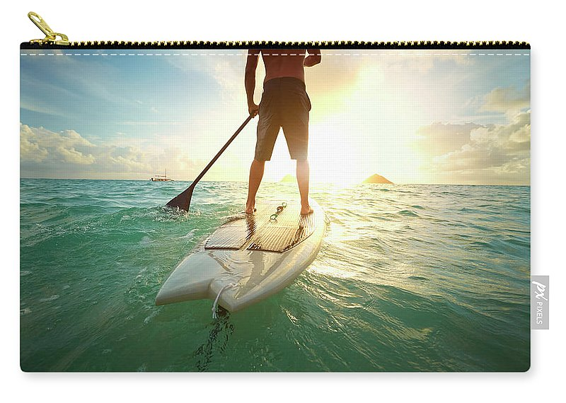 Tranquility Carry-all Pouch featuring the photograph Caucasian Man On Paddle Board In Ocean by Colin Anderson Productions Pty Ltd