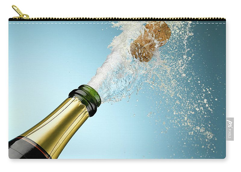 Celebration Carry-all Pouch featuring the photograph Champagne And Cork Exploding From Bottle by Andy Roberts