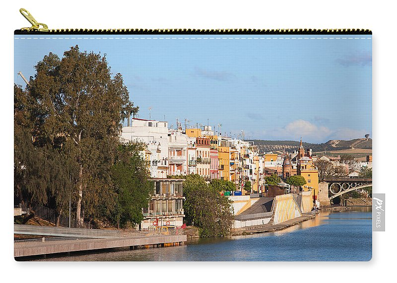 Seville Carry-all Pouch featuring the photograph City Of Seville In Spain by Artur Bogacki