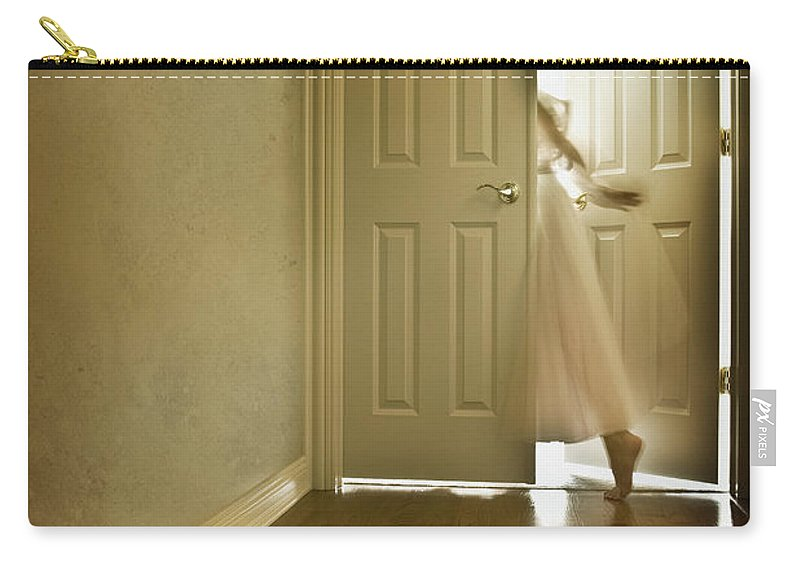Memory; Woman; Female; Lady; Ghost; Caucasian; Dress; Pink; Flowing; Blur; Foot; Barefoot; Door; Doorway; Wood Floors; Closed; Open; Going Into The Light; Light; Bright; Heaven; Death; Wall; House; Home; Indoors; Inside; Hall; Foyer; Walking; Conceptual Carry-all Pouch featuring the photograph Entrance by Margie Hurwich