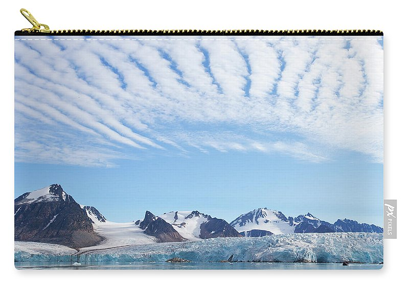 Scenics Carry-all Pouch featuring the photograph Glaciers Tumble Into The Sea In The by Anna Henly