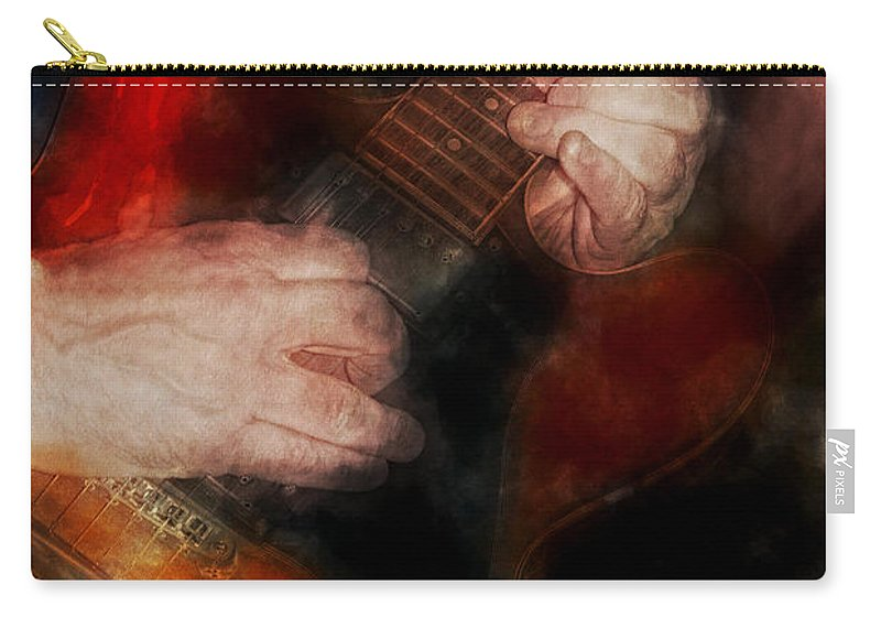 Band Carry-all Pouch featuring the photograph Guitar Traveling Pigments by David Lange