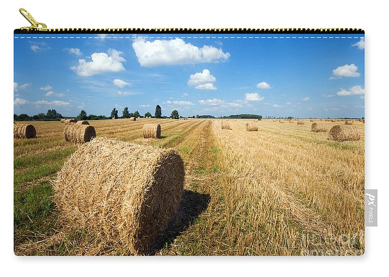 Harvest Carry-all Pouch featuring the photograph Haystacks In The Field by Michal Bednarek