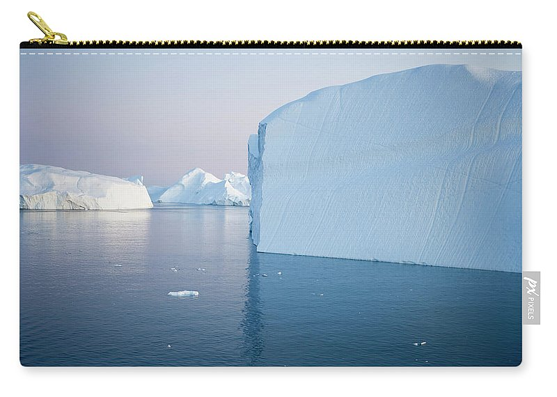 Melting Carry-all Pouch featuring the photograph Icebergs Of Ilulissat Kangerlua by Holger Leue