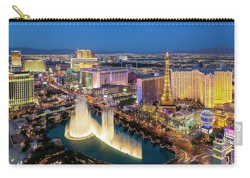Las Vegas Replica Eiffel Tower Carry-all Pouch featuring the photograph Las Vegas Skyline At Dusk by Sylvain Sonnet