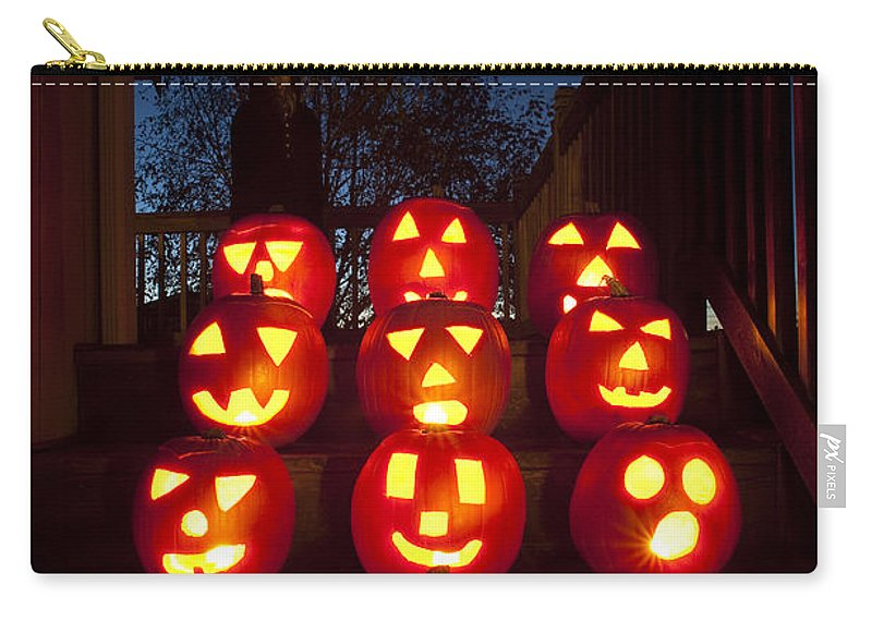31st Carry-all Pouch featuring the photograph Lit Pumpkins With Demon On Halloween by Jim Corwin