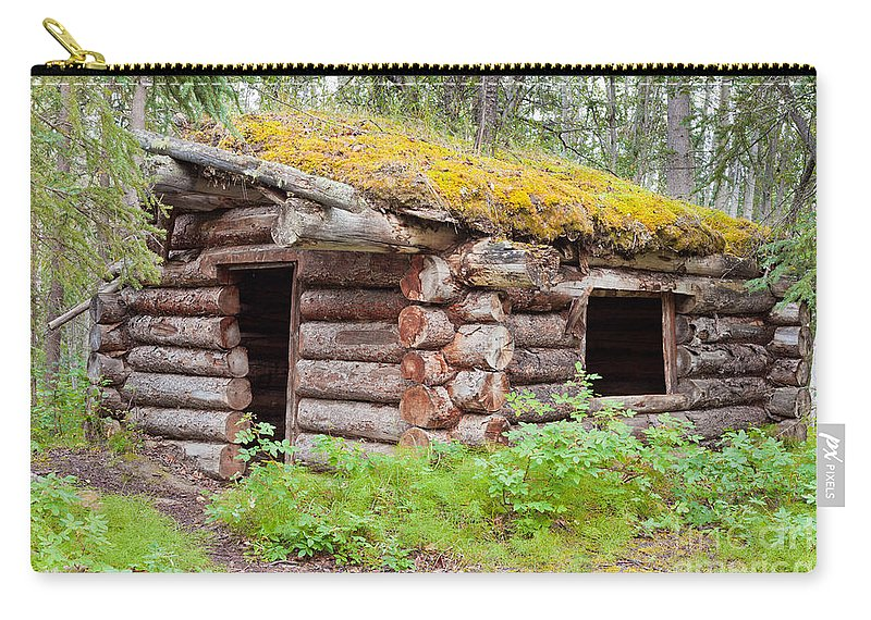 Abandoned Carry-all Pouch featuring the photograph Old Traditional Log Cabin Rotting In Yukon Taiga by Stephan Pietzko