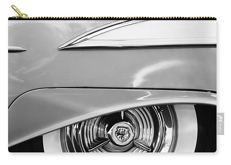 Oldsmobile 98 Wheel Emblem Carry-all Pouch featuring the photograph Oldsmobile 98 Wheel Emblem by Jill Reger