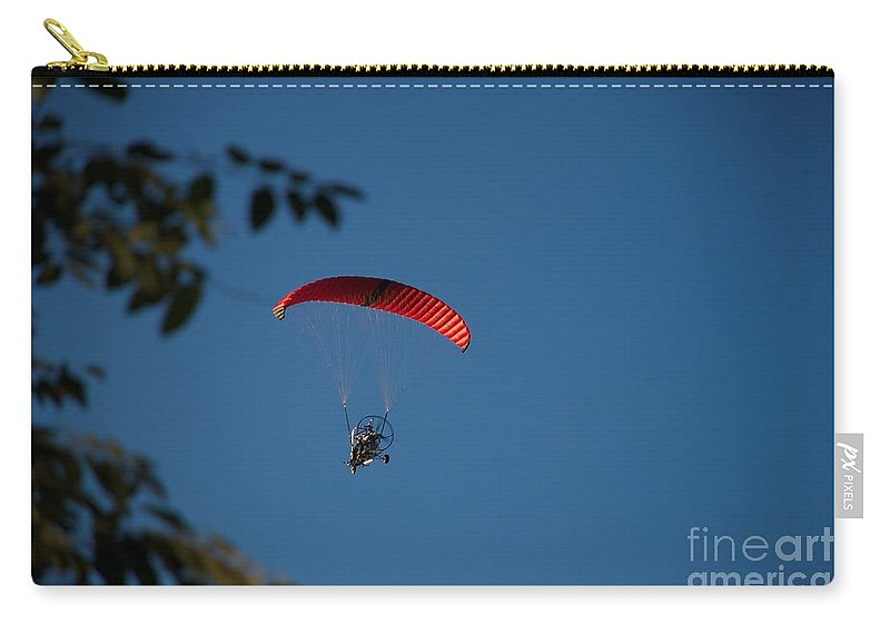 Parasailing Carry-all Pouch featuring the photograph Overflight by Joseph Yarbrough