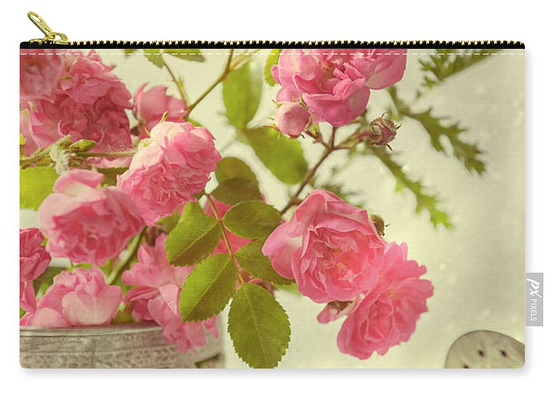 Pink Carry-all Pouch featuring the photograph Roses In Watering Can by Amanda Elwell