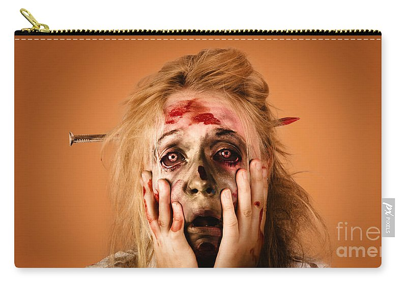 Halloween Carry-all Pouch featuring the photograph Shocked Horror Halloween Zombie With Hands Face by Jorgo Photography - Wall Art Gallery