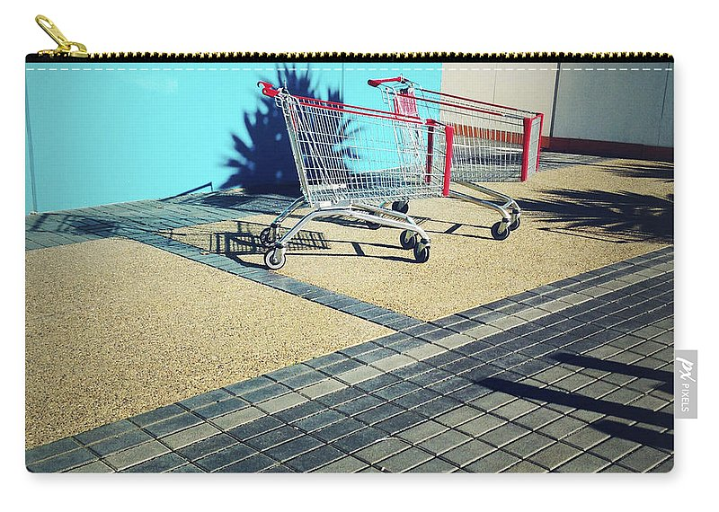 Cart Carry-all Pouch featuring the photograph Shopping Trolleys by Les Cunliffe