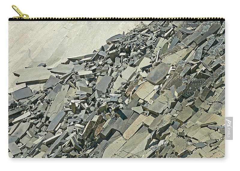 Strata Carry-all Pouch featuring the photograph Slipping And Sliding by Steve Taylor