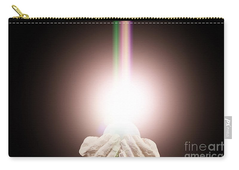 Spiritual Carry-all Pouch featuring the photograph Spiritual Light In Cupped Hands On A Black Background by Simon Bratt Photography LRPS