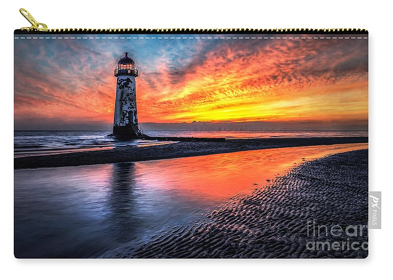 Lighthouse Carry-all Pouch featuring the photograph Sunset Lighthouse by Adrian Evans