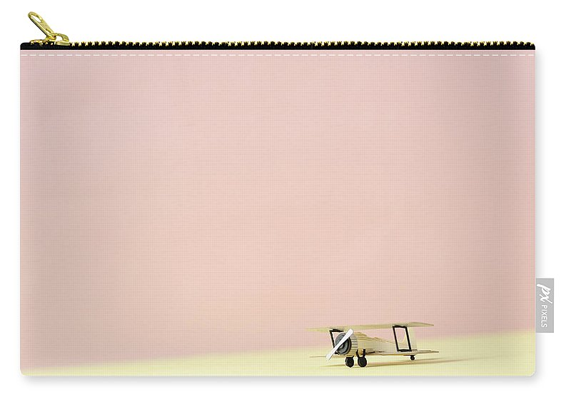 Shadow Carry-all Pouch featuring the photograph The Model Of The Airplane Made Of The by Yagi Studio