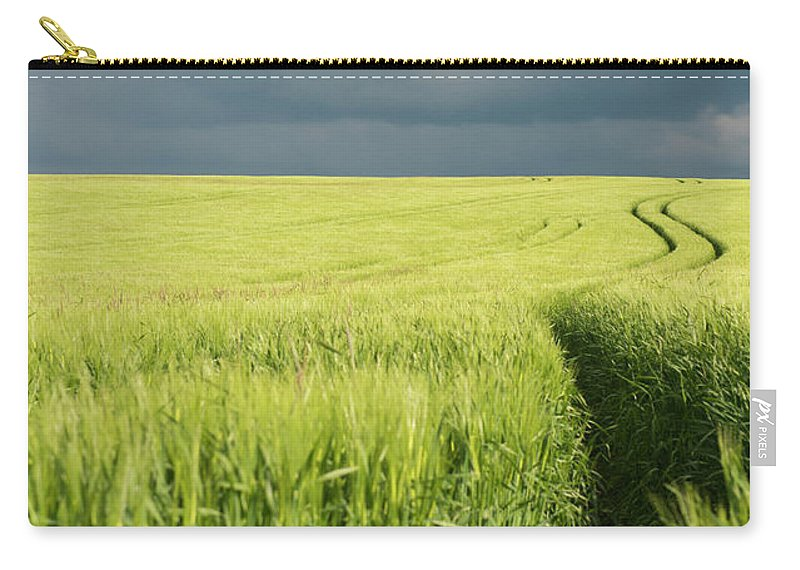 Tranquility Carry-all Pouch featuring the photograph Tire Tracks In Grain Field by Thomas Winz
