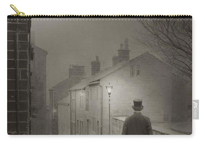 Man Carry-all Pouch featuring the photograph Victorian Or Edwardian Gentleman Walking Down A Cobbled Road At by Lee Avison