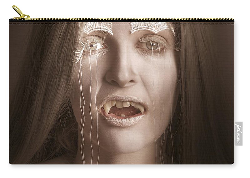Vampire Carry-all Pouch featuring the photograph Vintage Halloween Portrait. Gothic Vampire Girl by Jorgo Photography - Wall Art Gallery