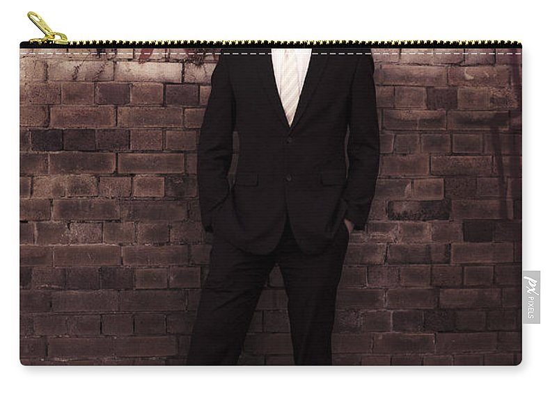 Person Carry-all Pouch featuring the photograph Vintage Salesman Standing In Front Of Brick Wall by Jorgo Photography - Wall Art Gallery