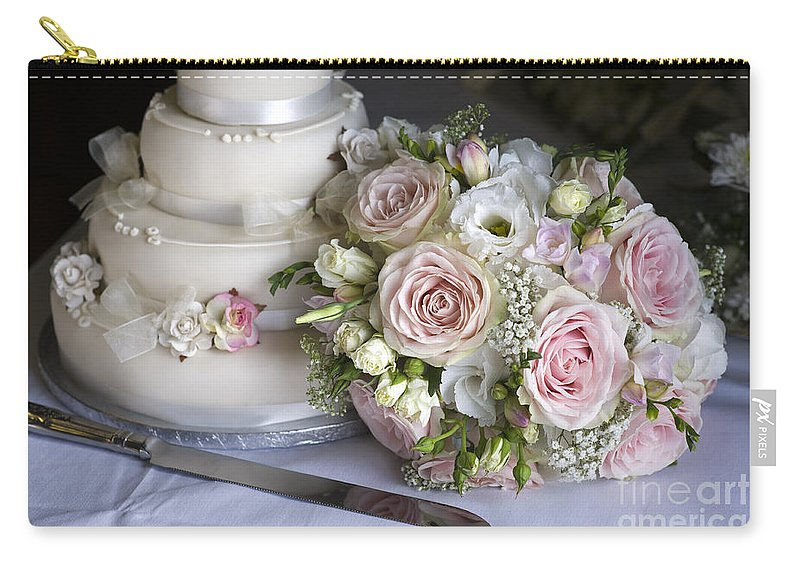 Wedding Cake Carry-all Pouch featuring the photograph Wedding Bouquet And Cake by Lee Avison