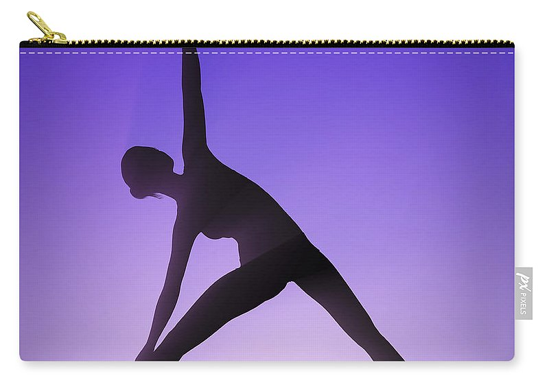 Flexibility Carry-all Pouch featuring the photograph Yoga Triangle Pose by Science Picture Co