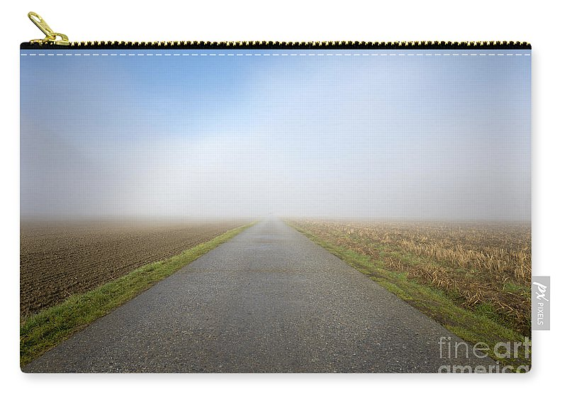 Street Carry-all Pouch featuring the photograph Foggy Road by Mats Silvan