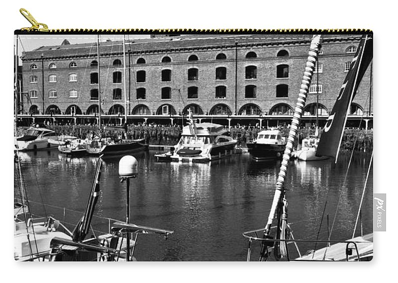 River Thames Carry-all Pouch featuring the photograph St Katherines Dock London by David Pyatt