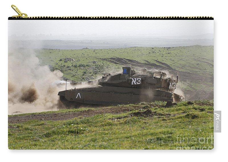 Battletank Carry-all Pouch featuring the photograph An Israel Defense Force Merkava Mark Iv by Ofer Zidon