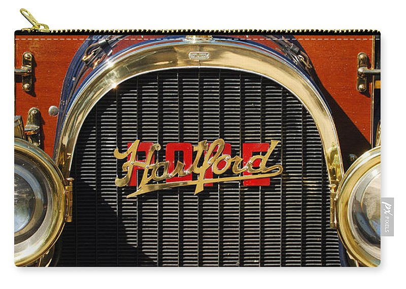1910 Pope Hartford Model T Grille Emblem Carry-all Pouch featuring the photograph 1910 Pope Hartford Model T Grille Emblem by Jill Reger