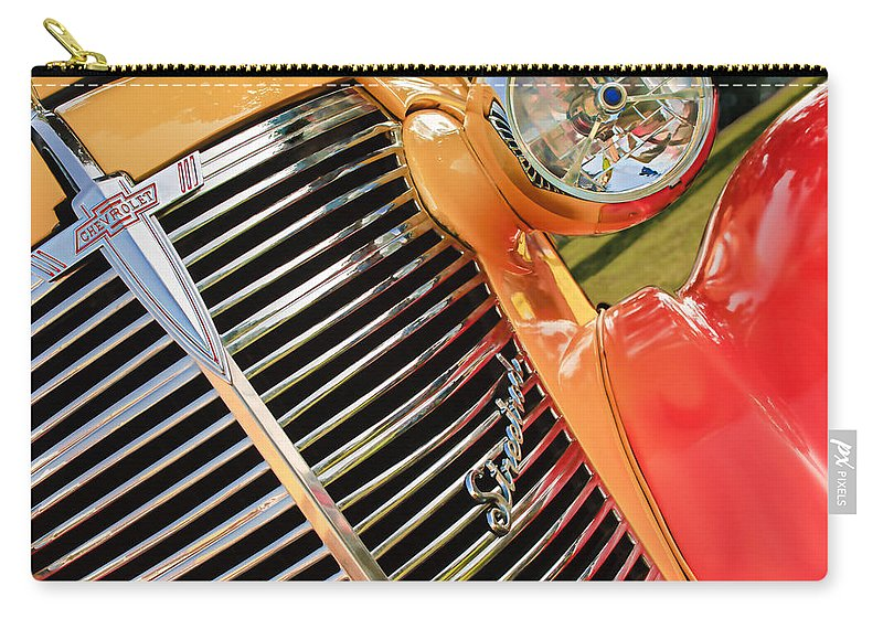 1938 Chevrolet Coupe Grille Emblems Carry-all Pouch featuring the photograph 1938 Chevrolet Coupe Grille Emblems by Jill Reger