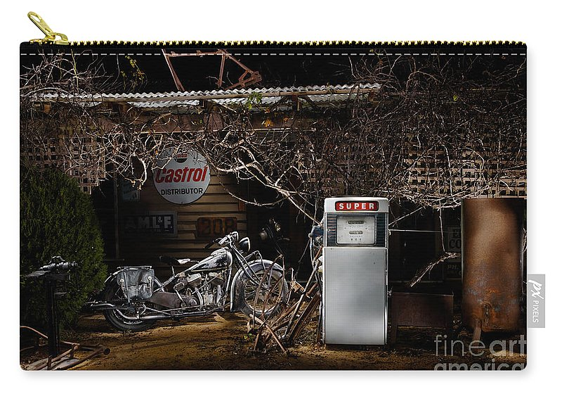 Classic Carry-all Pouch featuring the photograph 1939 Indian Chief At An Old Garage by Frank Kletschkus