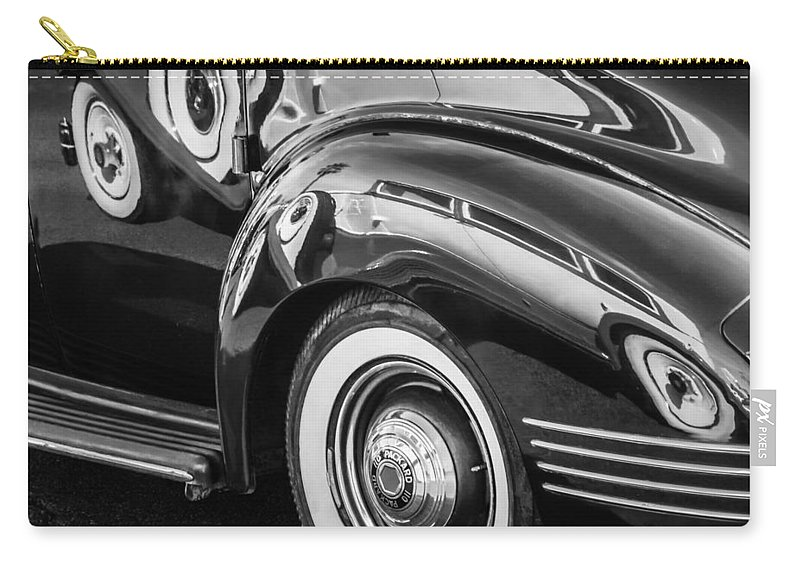 1941 Packard 110 Deluxe Carry-all Pouch featuring the photograph 1941 Packard 110 Deluxe -1092bw by Jill Reger
