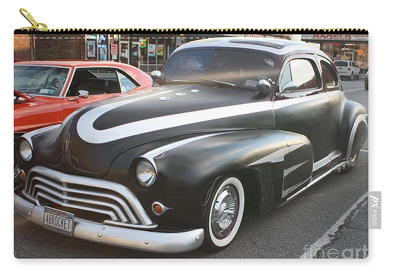 1948 Oldsmobile Sedan Carry-all Pouch featuring the photograph 1948 Oldsmobile Sedan by John Telfer