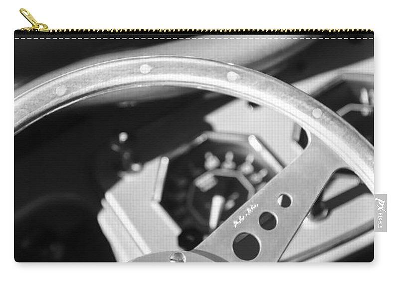1954 Mg Tf Steering Wheel Emblem Carry-all Pouch featuring the photograph 1954 Mg Tf Steering Wheel Emblem -0920bw by Jill Reger