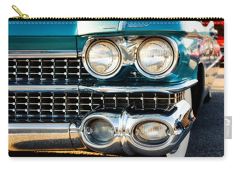 Cadillac Carry-all Pouch featuring the photograph 1959 Cadillac Sedan Deville Series 62 Grill by Jon Woodhams