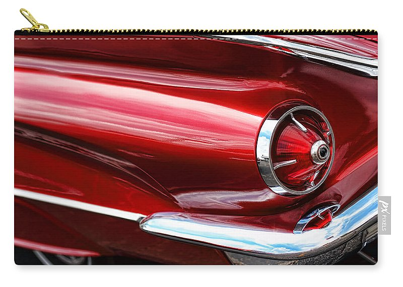 1960 Carry-all Pouch featuring the photograph 1960 Buick Lesabre by Gordon Dean II