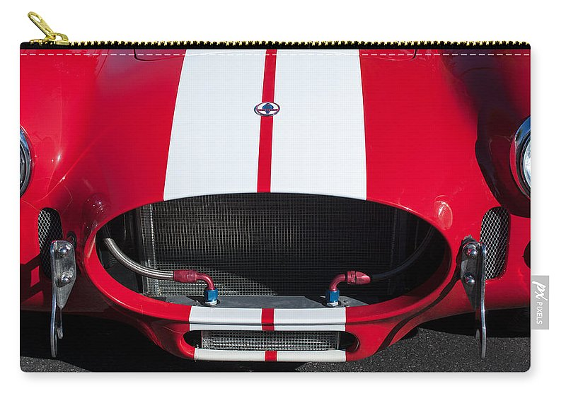 1965 Shelby Cobra Front Grille Emblem Carry-all Pouch featuring the photograph 1965 Shelby Cobra Front Grille - Emblem by Jill Reger