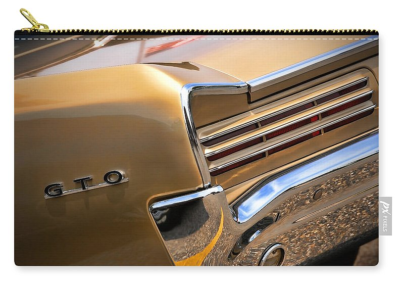 1966 Carry-all Pouch featuring the photograph 1966 Pontiac Gto Tail by Gordon Dean II