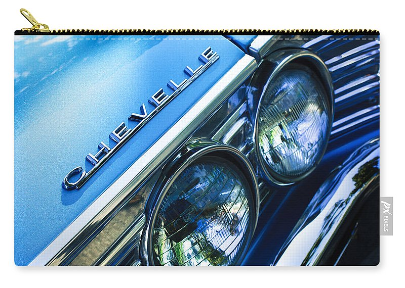 1967 Chevrolet Chevelle Malibu Head Light Emblem Carry-all Pouch featuring the photograph 1967 Chevrolet Chevelle Malibu Head Light Emblem by Jill Reger